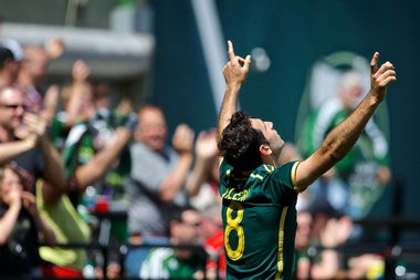 Portland Timbers midfielder Diego Valeri celebrates after scoring the equalizing goal in extra time against the Los Angeles Galaxy on May 11, 2014 at Providence Park.