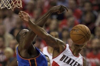 Portland Trail Blazers guard Damian Lillard (0) is fouled as The Portland Trail Blazers face the Oklahoma City Thunder at the Moda Center. Bruce Ely / The Oregonian