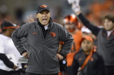 Mike Riley has been named head coach at the University of Nebraska, Dec. 4, 2014. FILE: Oregon State University football coach Mike Riley yells at an official during an NCAA college football game against the University of Utah in Corvallis, Ore., Thursday, Oct.. 16, 2014. The University of Utah beat Oregon State 29-23. (AP Photo/Troy Wayrynen)