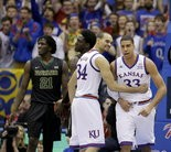 Kansas's Perry Ellis (34) celebrates with Landen Lucas (33) during the redshirt sophomore's big game against Baylor. His nine-point performance in limited minutes earned praise from coach Bill Self.