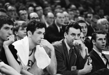 Princeton's head coach Bill Van Breda Kolff, right, and Bill Bradley, left, as they watch their team lose to Michigan 93-76 in the semi-finals of the National Collegiate Basketball Championships in Portland, Oregon on March 20, 1965. (AP Photo)