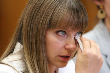 Brenda Tracy wipes away tears as she testifies at a legislative hearing April 1, 2015, on extending Oregon's statute of limitations in rape cases. Tracy and other sexual assault advocates are now asking the Senate to extend the statute to 20 years.