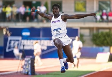 Florida's Marquis Dendy won the triple jump with a wind-aided leap of 58 feet, 1 1/4 inches.