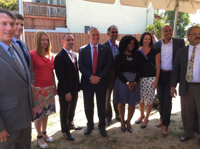 City Council members and community leaders, including Maxine Fitzpatrick, celebrate a proposed affordable housing project in Northeast Portland on Aug. 17, 2015.