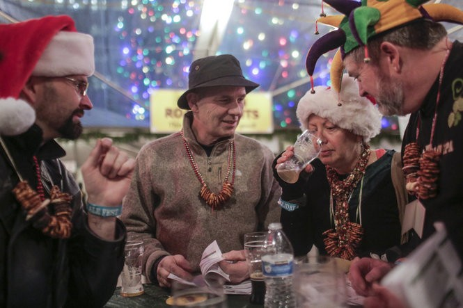 Sam Fisher (from left to right), Mark Meadows, Meg Lewis-Price and Ben Fisher go in for the serious tasting at the 2015 Holiday Ale Festival in Pioneer Courthouse Square.