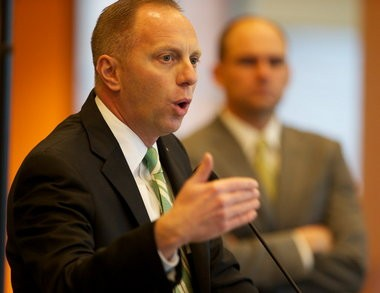 Oregon athletic director Rob Mullens introduces new coach Mark Helfrich in 2013.