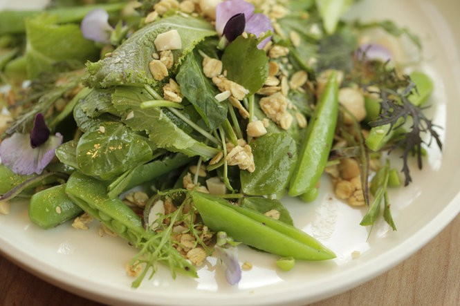 Snap peas with maple-mustard vinaigrette, pea shoots and benne seeds at Coquine.