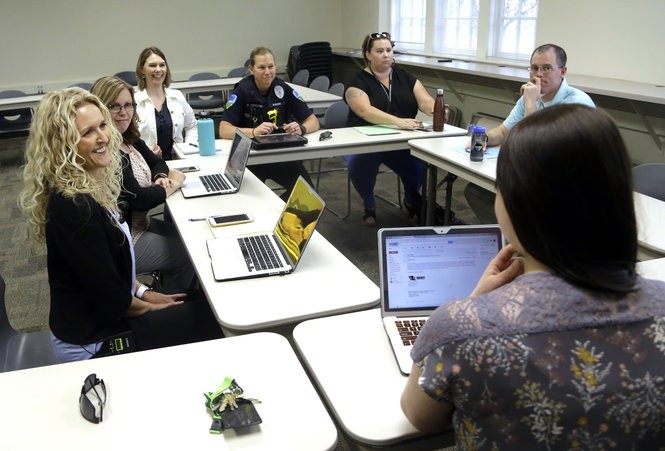 Sexual Incident Response Committee members meet at Forest Grove School District headquarters. The group meets regularly to discuss more serious sexual incident cases they are monitoring. The group includes school and district administrators, local law enforcement, juvenile social workers, child protection officials and a psychologist. (AP Photo/Don Ryan)