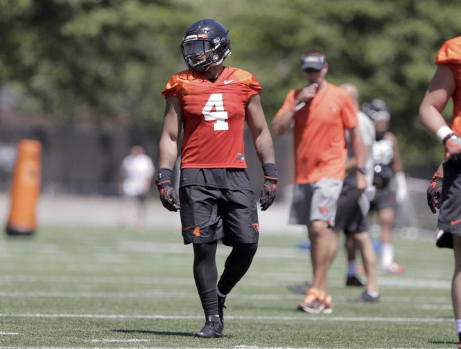 Running back Thomas Tyner looks toward the sideline as the Oregon State Beavers open fall camp with the first football practice of the 2017 season in Corvallis on Tuesday, July 25, 2017.