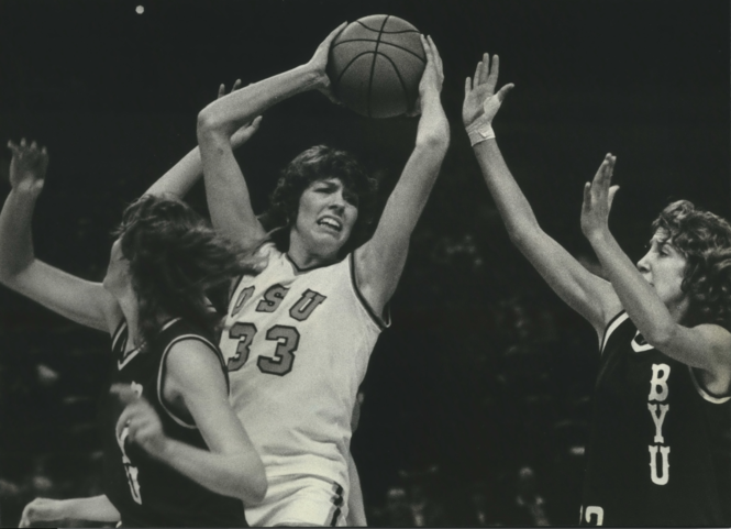 In a December 1980 tournament in Portland, Oregon State's Carol Menken fights to hold onto a rebound against BYU. She still holds the OSU single-game school record with 51 points, set 10 months earlier in February 1980.