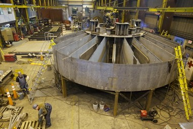 Employees at Oregon Iron Works in Clackamas build a prototype of a wave energy buoy in April or 2010. The buoy is part of on ongoing effort to figure out the best way to produce electricity from the movement of ocean waves.