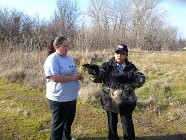 Daughter and mother Sylvia and Denise Minthorn have both heard the strange nighttime cries coming from the brushy wetland behind them. Denise thinks whatever is in the swamp is calling to another creature elsewhere on the 178,000-acre Umatilla Indian Reservation.