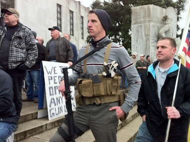 Ryan Wiley, of Washington County, joined like-minded Second Amendment supporters Saturday in front of the Oregon State Capitol building. The crowd, carrying assault rifles, shotguns and other firearms, voiced their opposition to gun control proposals made recently by President Barack Obama and state Sen. Ginny Burdick, D-Portland.