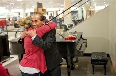 "Aimee Hentschell of Gig Harbor hugs Juan Perez after he closed up the piano for the last time at Nordstrom at the Tacoma Mall on Sunday. ""You played at my wedding,"" she exclaimed. It was his last day there and Nordstrom will discontinue live piano music."