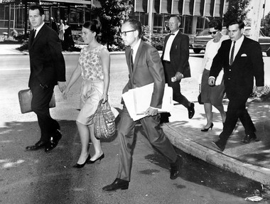 Annette Buchanan, second from left, heads to the Lane County Courthouse on June 28, 1966 to explain why she should not be held in contempt for failing to reveal her sources in a marijuana story that run in May in the Daily Emerald. Her attorney, Art Johnson, (left) and others accompanied her to court.