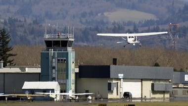 A small plane takes off past the control tower at Troutdale Airport on Thursday, March 7, 2013. Five small airports in Oregon are on the Federal Aviation Administration list for potential control tower closings under the automatic budget cuts known as sequestration that took effect March 1.