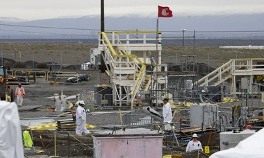 Workers labor at the 'C' Tank Farm at the Hanford Nuclear Reservation, Wednesday, March 6, 2013, near Richland, Wash.