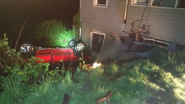 A car flipped off the highway and collided with a house north of Aurora at about 8:30 p.m. Saturday.