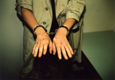 Kipland P. Kinkel shows his hands to police after his arrest May 21, 1998.