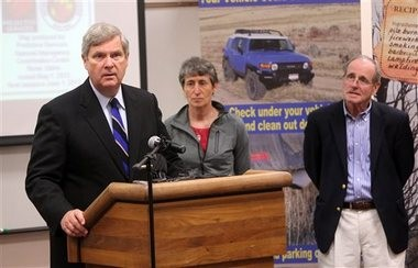 Secretary of the Interior Sally Jewell (center) Agriculture Secretary Tom Vilsack (left) and Idaho Sen. Jim Risch hold a press conference on Monday at the National Interagency Fire Center in Boise. With another extreme Western fire season predicted, Vilsack and Jewell are visiting the center to discuss what their agencies are doing to prepare.