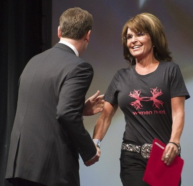 THe National Rifle Association's Institute for Legislative Action executive director Chris W. Cox, left, greets former Alaska Gov. Sarah Palin during the leadership forum at the National Rifle Association's annual meeting Friday, May 3, 2013 in Houston.