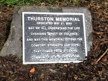 "A marker at the shooting memorial outside Thurston High School starts out: ""May we all understand the life-changing impact of violence."""