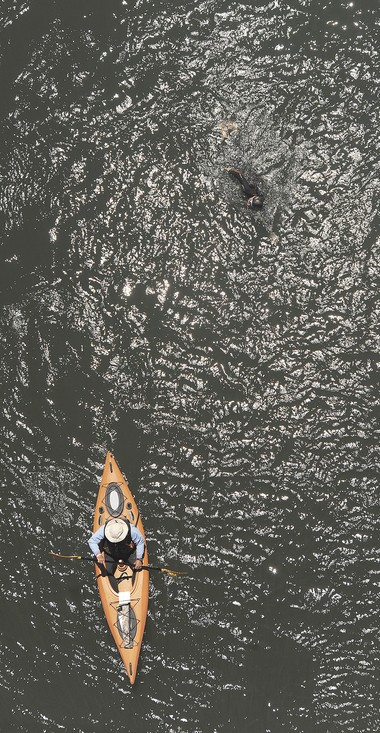 Dick Hall, of Portland, leads his son, Dean, of Gresham, as he swims in the Willamette River near Corvallis on June 9, 2014.