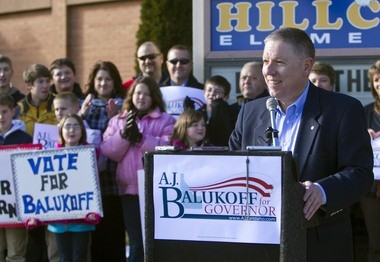 Idaho businessman and school board member A.J. Balukoff, right, announces his candidacy for governor in Boise, Idaho, in December 2013.
