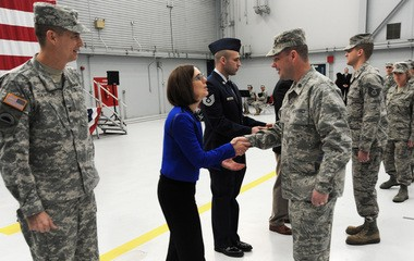 Kate Brown, who was then Oregon's secretary of state, greets Lt. Col. Jason Lay, 142nd Fighter Wing Civil Engineer Squadron commander after a demobilization ceremony at the Portland Air National Guard Base in December.