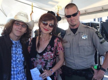 Joshua Peterson, singer Pam Tillis and Deputy Terry Brown at the Cape Blanco music festival in Sixes in August. Two months earlier, Brown had rescued Joshua from the ocean off Harris Beach.