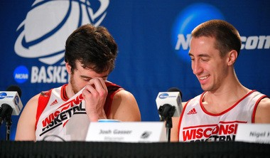 University of Wisconsin basketball player Frank Kaminsky (left), with fellow player Josh Gasser, smells his body odor during a press conference at the NCAA college basketball tournament on March 27, 2015, in Los Angeles. Researchers presenting a paper at the Society for General Microbiology's 2015 Annual Conference say they've identified a bacterial gene involved in a biochemical process that's largely responsible for the stink of body odor.