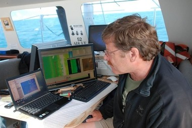 Chris Goldfinger checks data aboard a vessel while researching earthquakes. OSU maintains one of the nation's largest archives of sediment cores to reconstruct past quake and climate scenarios.