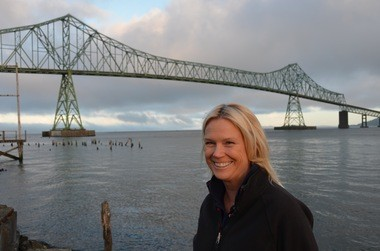 Columbia River pilot Anne McIntyre enjoys the morning sun by the bridge she views as a landmark heralding the start and finish of her journeys up and down the shipping channel. The slideshow at top includes photos of a recent voyage she made upriver at the helm of the 34,000-ton Andalucian Zephyr.