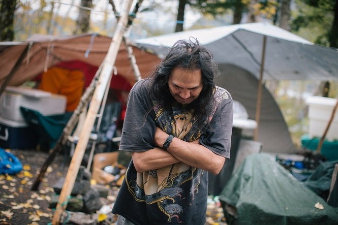 Ian Tohet, a Warm Springs tribe member, was one of six people at the Wyeth seasonal tribal fishing site in early September,2015.. He and his family live in a tent and cook outdoors.