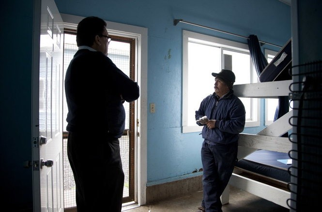 Farmworkers union president Ramon Ramirez (left) talks with the foreman of a labor camp off Leary Road in Woodburn, Oregon. Woodburn lies at the heart of Oregon's richest agricultural region. In Woodburn, Latinos make up 60 percent of the town's population. They aren't the fringe but the very fabric of the town. This winter, deportation fears threatened to turn Woodburn into a ghost town. Casey Parks/The Oregonian