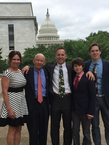 Rep. Peter DeFazio with the Mansfield family outside the Capitol in 2017. DeFazio has introduced a bill banning the type of predator control device that killed the Mansfield's dog outside of Pocatello.