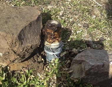 FILE - This Thursday, March 16, 2017 file photo released by the Bannock County Sheriff's Office shows an M-44 cyanide device in Pocatello, Idaho. (Bannock County Sheriff's Office via AP, File)
