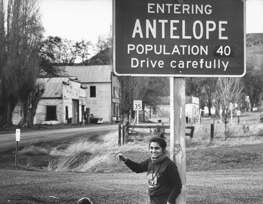 Ma Anand Sheela poses in front of the Antelope sign in 1982.