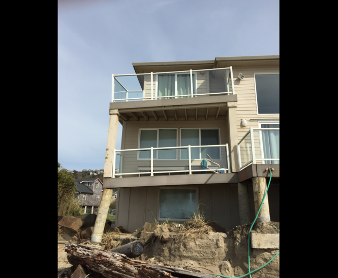 Decks now collapsing on Oregon beach house at center of