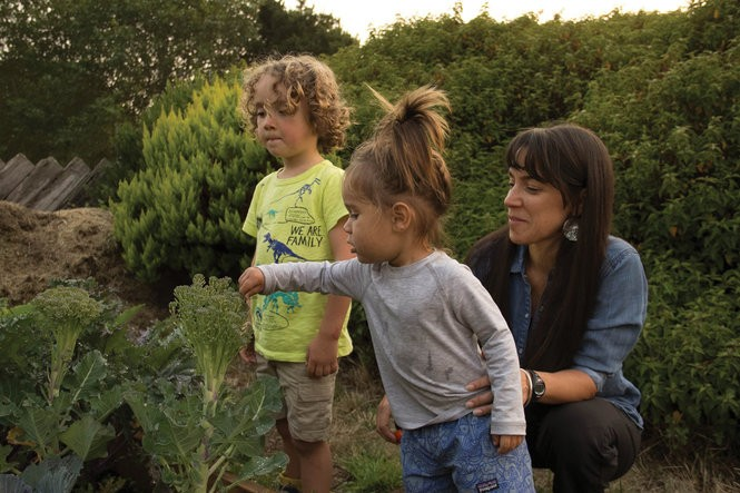Amy Cordalis, at home with sons Brooks and Keane in their backyard garden in McKinleyville, California.