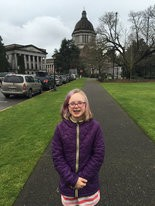 Emma Patterson, 16, in front of the Capitol dome in Olympia at the beginning of her legislative advocacy journey.