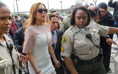 Actress Lindsay Lohan arrives late at the Los Angeles Superior Court on Monday.