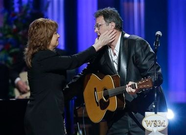 Patty Loveless embraces Vince Gill (right) after they performed during the funeral for country music star George Jones in the Grand Ole Opry House on Thursday in Nashville. Jones, one of country music's biggest stars who had No. 1 hits in four separate decades, died April 26.