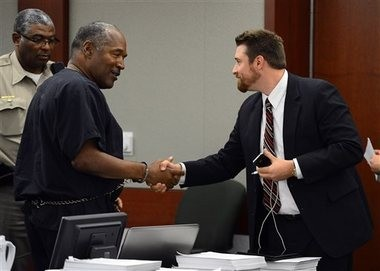 O.J. Simpson shakes hands with defense team member Josh Barry at the end of an evidentiary hearing in Clark County District Court on Friday in Las Vegas.