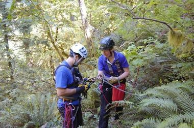 OHSTAR members John Thoeni, left, and Ulli Neithch prepare to rappel down a ravine to rescue Riley, a hound mix who fell while hiking on the Oneonta Trail in September 2012.