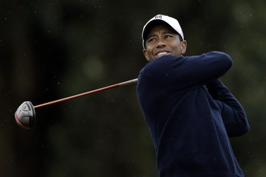 Tiger Woods watches his tee shot on the 15th hole of the north course at Torrey Pines during the second round of the Farmers Insurance Open golf tournament today in San Diego.