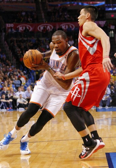 promo code d5dce 32b9d ï® Oklahoma City Thunder forward Kevin Durant, left, drives to the  basket around