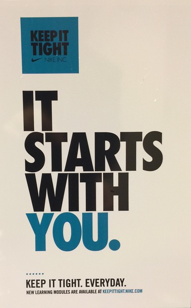 This is a poster on the Nike campus that promotes the 'Keep It Tight' security education program. (Allan Brettman)