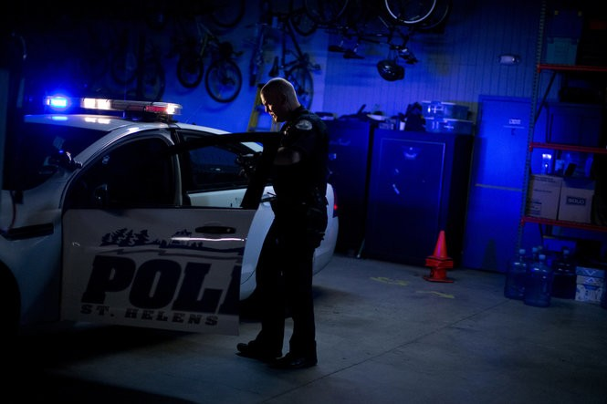 Officer Evin Eustice of the St. Helens Police Department readies his patrol car before beginning an early morning shift. (Photo by Beth Nakamura)