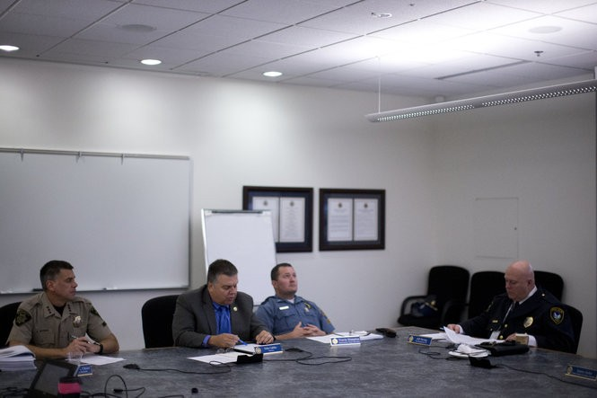 From left: the Department of Public Safety Standards and Training board chair, Marion County Sheriff Jason Myers; the department's director, Eriks Gabliks; Oregon State Police Superintendent Travis Hampton, who is a board member; and Jeffrey Hering of the Tigard Police Department, another board member. (Photo by Beth Nakamura)